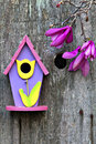 Pink, purple and yellow birdhouse Royalty Free Stock Image