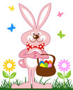 Pink rabbit with basket of easter eggs Royalty Free Stock Photo