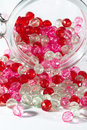 Pink and red beads jar full of a clear for haberdashery Royalty Free Stock Photo