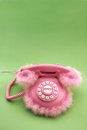 Pink retro phone with copy space on green background Stock Image