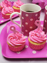 Pink ribbon morning tea vertical cupcakes with symbol for international breast cancer awareness charity month of october with Royalty Free Stock Photo