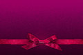 Pink ribbon on purple background elegant bow textured with copy space bright colors Royalty Free Stock Image