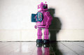 Pink robot toy on wooden floor Stock Image