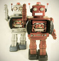 Pink robot two retro toys toned image Stock Photo