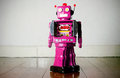 Pink robot on a wooden floor Stock Images
