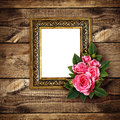 Pink rose flowers arrangement and a frame on wood Royalty Free Stock Photo