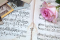 Pink rose with old photographs and old sheets of music Stock Images