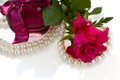 Pink rose with pearl necklace