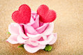 Pink rose with two red heart. Royalty Free Stock Photo