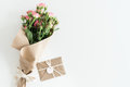 Pink roses bouquet in kraft paper and envelope isolated on white with copy space
