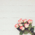 Pink roses bouquet on white tablecloth with copy space. Toned, soft focus. Royalty Free Stock Photo