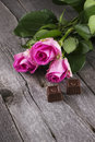 Pink roses and chocolates in form of heart on a dark background Royalty Free Stock Images