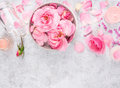 Pink roses cosmetics set with cream bottle candles petals and sea salt spa background space for text top view Royalty Free Stock Photography