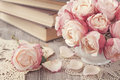 Pink roses and old books Royalty Free Stock Photography