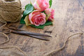 Pink roses with old rusty antique scissors bouquet of rose flowers and ball of brown twine Stock Photo