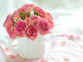 Pink roses in white cup for celebration selective focus Royalty Free Stock Image
