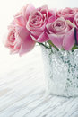 Pink roses in a white lace vase Royalty Free Stock Photo