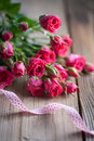 Pink roses on a wooden table bouquet of background Stock Photos