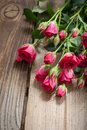 Pink roses on a wooden table bouquet of background Royalty Free Stock Photos