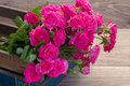 Pink roses on wooden table pile of fresh close up background Royalty Free Stock Photography