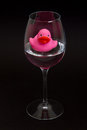 Pink rubber duck in a wineglass Royalty Free Stock Photo