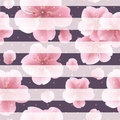 Pink sakura flowers with petals on the striped background seamless pattern with summer flowers dots and lines modern concept Royalty Free Stock Image