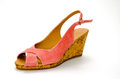 Pink sandal foreground on white background Royalty Free Stock Image