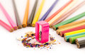 Pink sharpener arounded with pencil on white background Stock Image