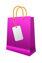 Pink shopping bag with paper handles on white background Royalty Free Stock Photography