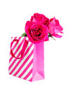 Pink shopping bag and pink roses isolated on white Royalty Free Stock Photo