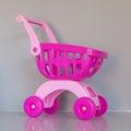 stock image of  Pink shopping cart