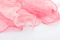 Pink silk scarf on the white background Royalty Free Stock Images