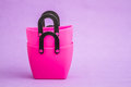 Pink Small Decorative Plastic Bags with handle on Purple  Backgr Royalty Free Stock Photo