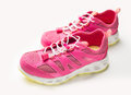 Pink sneakers on a light Royalty Free Stock Photo