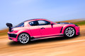 Pink sports car Stock Image
