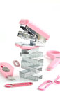 Pink stapler with office accessories on white background Stock Photos