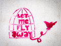 Pink stencil graffiti with bird leaving a cage freedom expression Royalty Free Stock Image