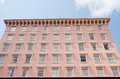 A pink stucco hotel in charleston south carolina with many windows Royalty Free Stock Image