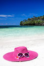 Pink summer hat on beach with sunglasses and plumeria panama tropical nobody vacation concept Royalty Free Stock Image