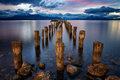 Pink sunset in chile patagonia with a broken pier Royalty Free Stock Images