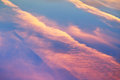 Pink sunset clouds in blue spring sky Royalty Free Stock Photos