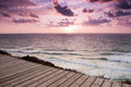 Pink sunset sun setting in the mediterranian sea off the caost of israel Royalty Free Stock Images