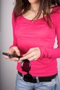 Pink sweater woman typing Stock Photo