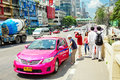 Pink taxi of bangkok thailand april pedestrians stopped a in there are taxis in all are metered with the starting fee Royalty Free Stock Images