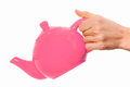 Pink teapot isolated in hand on white background and clipping path Stock Images