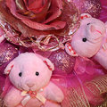 Pink teddy bears and artificial flower in the christmas composit two original composition of color with a cloth artificially new Stock Image