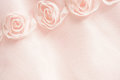 Pink textile background with roses Stock Photos