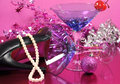 Pink theme Happy New Year party with vintage blue martini cocktail glass and New Years eve decorations after the party Royalty Free Stock Photo