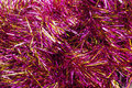 Pink tinsel garlands of christmas tree as a background Royalty Free Stock Photos