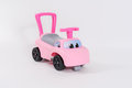 Pink toy car for kids to learn to walk on a white studio background Stock Image